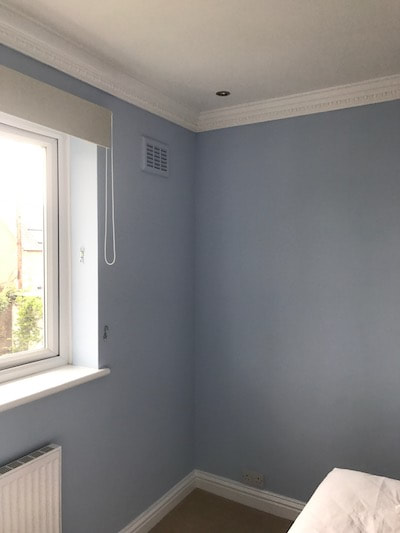 Corner view of a light blue bedroom in Brockworth that was painted by our Decorators Gloucester Team.