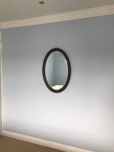 Our Decorators Gloucester team painted a subtle blue colour on the bedroom walls in a Brockworth house.