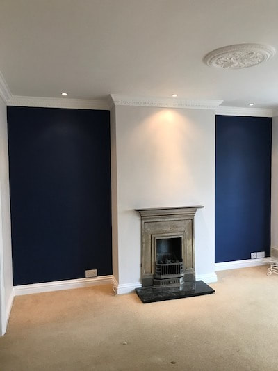 Painter and Decorator Gloucester did a lovely even finish on the dark blue feature walls either side of the period fireplace. The fireplace was in a living room in a house situated in Longlevens, Gloucester.