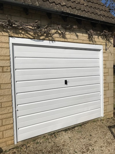 Photo of garage door painted by Painter And Decorator Gloucester in the Kingsholm area.