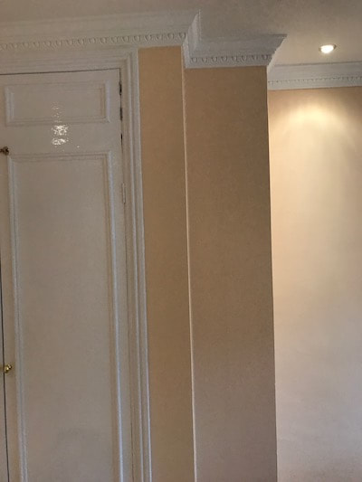 Painting and decorating in a Gloucester bedroom. A warm peach colour. Photo shows an interesting feature at the end of a built in wardrobe.