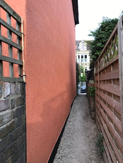 Photo of external painting and decorating job done in the Gloucester area. A lovely vibrant orange colour.