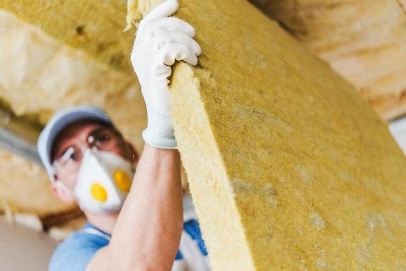 One Of Our Handyman Team Members Carrying Out ​​Loft Insulation.